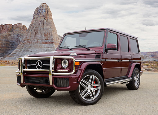 AUT 05 RK0696 01 © Kimball Stock 2013 Mercedes-Benz G63 AMG Maroon 3/4 Front View On Gravel In Desert