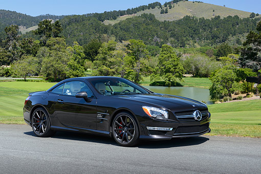 AUT 05 RK0698 01 © Kimball Stock 2013 Mercedes-Benz SL65 Black 3/4 Front View On Pavement By Golf Course