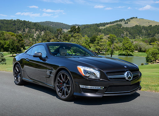 AUT 05 RK0699 01 © Kimball Stock 2013 Mercedes-Benz SL65 Black 3/4 Front View On Pavement By Golf Course