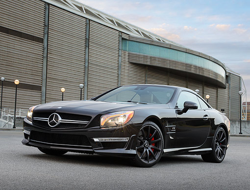 AUT 05 RK0701 01 © Kimball Stock 2013 Mercedes-Benz SL65 Black 3/4 Front View On Pavement By Building