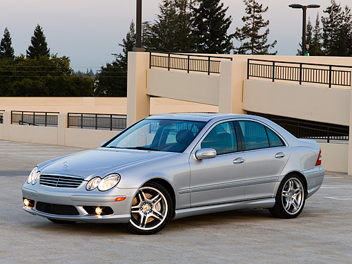 AUT 05 CW0004 01 © Kimball Stock 2006 Mercedes-Benz C55 AMG Silver 3/4 Side View On Pavement