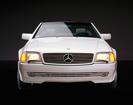 AUT 05 RK0180 08 © Kimball Stock 1995 Mercedes-Benz 500SL Convertible White Head On Shot Studio