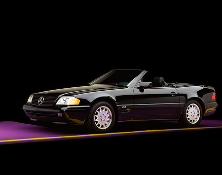 AUT 05 RK0066 04 © Kimball Stock 1997 Mercedes-Benz 600SL Convertible Black 3/4 Side View On Purple Floor Yellow Line Studio
