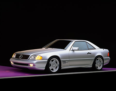 AUT 05 RK0078 01 © Kimball Stock 1997 Mercedes-Benz 500SL Sport Silver 3/4 Side View On Purple Floor Gray Line Studio