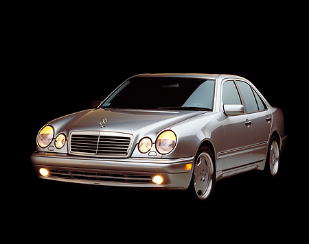 AUT 05 RK0110 02 © Kimball Stock 1999 Mercedes-Benz E55 AMG Silver 3/4 Front View Studio