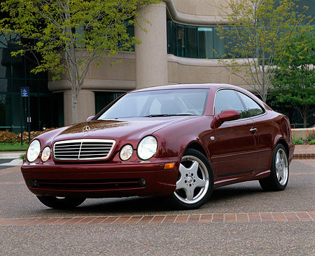 AUT 05 RK0144 01 © Kimball Stock 1999 Mercedes-Benz CLK430 Sport Coupe Bordeaux Red Front 3/4 View On Pavement