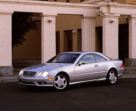 AUT 05 RK0187 04 © Kimball Stock 2001 Mercedes-Benz CL600 Silver 3/4 Side View By Pillars On Pavement