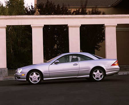 AUT 05 RK0189 02 © Kimball Stock 2001 Mercedes-Benz CL600 Silver Profile By Pillars On Pavement