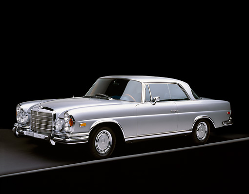 AUT 05 RK0206 01 © Kimball Stock 1971 Mercedes 280 SE Coupe Silver 3/4 Side View On Gray Line Studio