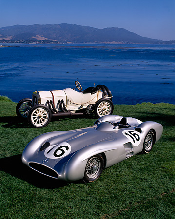 AUT 05 RK0211 02 © Kimball Stock 1954 And 1908 Mercedes-Benz Race Cars On Grass By Water