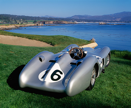 AUT 05 RK0214 04 © Kimball Stock 1954 Mercedes W196 Race Car Silver 3/4 Rear View On Grass By Water