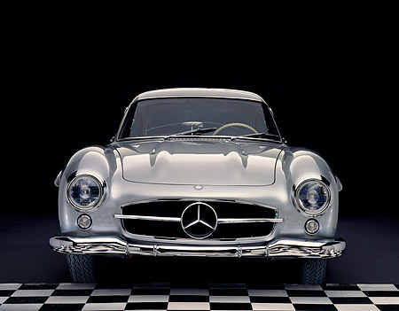AUT 05 RK0232 07 © Kimball Stock 1955 Mercedes-Benz 300SL Gullwing Silver Head On Checkered Floor Studio
