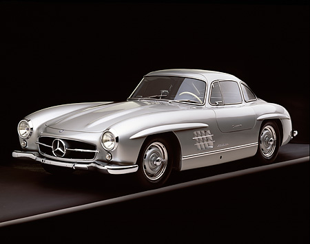 AUT 05 RK0235 02 © Kimball Stock 1955 Mercedes-Benz 300SL Gullwing Silver 3/4 Front View On Gray Line Studio
