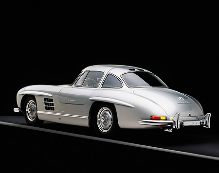 AUT 05 RK0236 08 © Kimball Stock 1955 Mercedes-Benz 300SL Gullwing Silver 3/4 Rear View On Gray Line Studio
