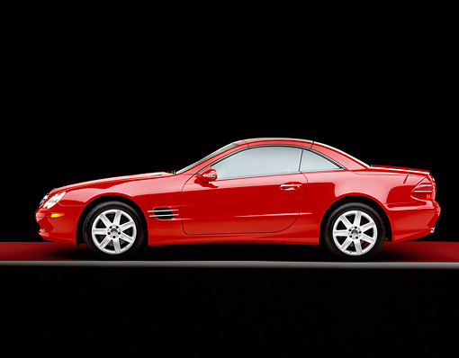 AUT 05 RK0277 01 © Kimball Stock 2003 Mercedes Benz SL500 Red Convertible Profile On Red Floor Gray Line Studio