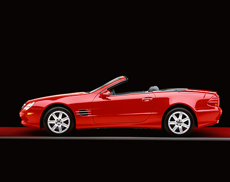 AUT 05 RK0278 03 © Kimball Stock 2003 Mercedes SL500 Red Convertible Profile On Red Floor Gray Line Studio