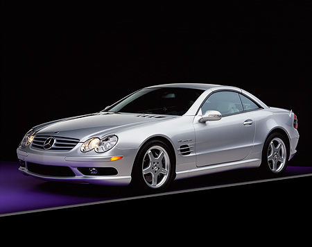 AUT 05 RK0284 05 © Kimball Stock 2003 Mercedes SL55 AMG Roadster Silver 3/4 Front View On Purple Floor Gray Line Studio