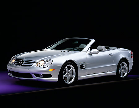 AUT 05 RK0284 09 © Kimball Stock 2003 Mercedes SL55 AMG Roadster Silver 3/4 Front View On Purple Floor Gray Line Studio