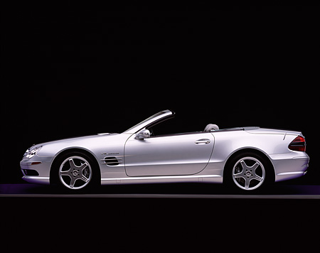 AUT 05 RK0286 01 © Kimball Stock 2003 Mercedes SL55 AMG Roadster Silver Profile On Gray Line Studio