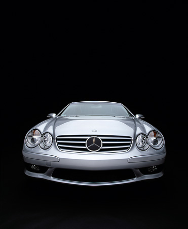 AUT 05 RK0288 13 © Kimball Stock 2003 Mercedes SL55 AMG Roadster Silver Wide Angle Head On Shot Studio
