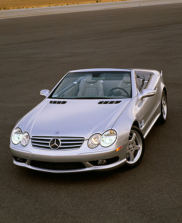 AUT 05 RK0294 04 © Kimball Stock 2003 Mercedes SL55 AMG Roadster Silver Overhead 3/4 Front View On Pavement