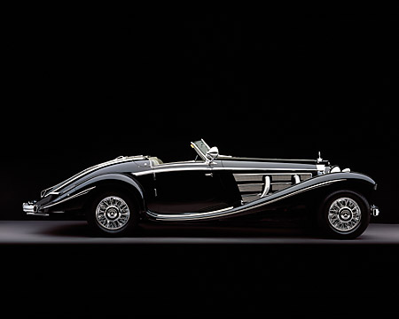 AUT 05 RK0337 05 © Kimball Stock 1937 Mercedes-Benz 540K Special Roadster Black Profile View Studio