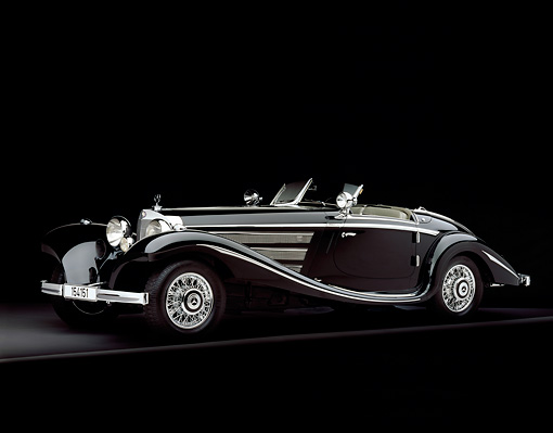 AUT 05 RK0343 11 © Kimball Stock 1937 Mercedes-Benz 540K Special Roadster Black 3/4 Side View On Gray Line Studio