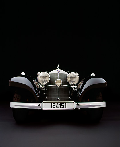 AUT 05 RK0347 05 © Kimball Stock 1937 Mercedes-Benz 540K Special Roadster Black Head On Gray Floor Studio