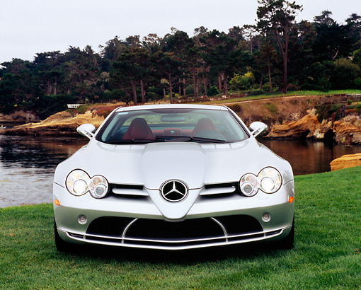 AUT 05 RK0370 01 © Kimball Stock 2005 Mercedes-Benz SLR McLaren Silver Head On View On Grass By Water