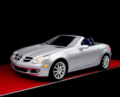 AUT 05 RK0389 02 © Kimball Stock 2005 Mercedes-Benz SLK350 Convertible Silver 3/4 Side View On Red Floor Studio