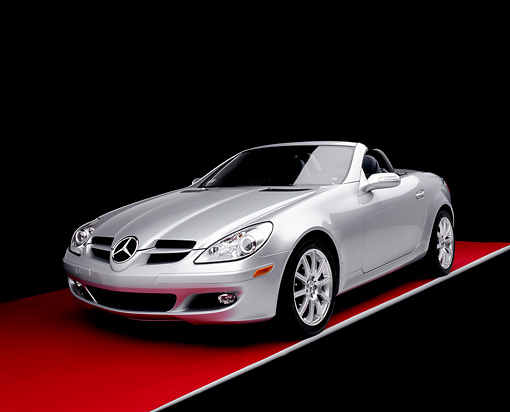 AUT 05 RK0390 02 © Kimball Stock 2005 Mercedes-Benz SLK350 Convertible Silver 3/4 Front View On Red Floor Studio