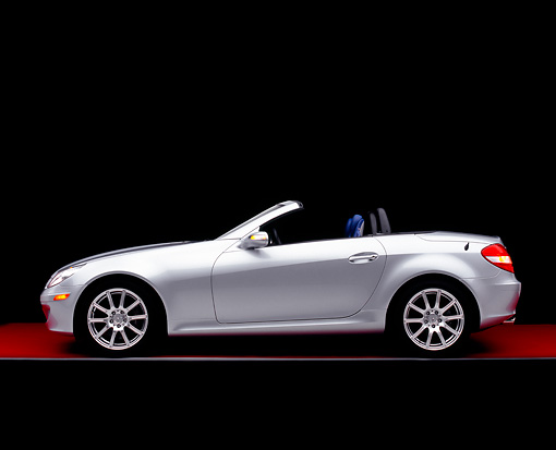 AUT 05 RK0391 09 © Kimball Stock 2005 Mercedes-Benz SLK350 Convertible Silver Profile View Red Floor Studio