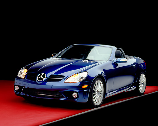 AUT 05 RK0407 07 © Kimball Stock 2005 Mercedes SLK55 Roadster Blue 3/4 Front View On Red Floor Gray Line Studio