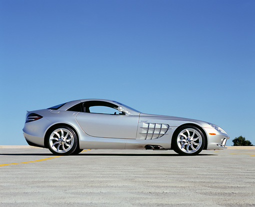 AUT 05 RK0432 03 © Kimball Stock 2005 Mercedes-Benz SLR McLaren Silver Profile On Pavement