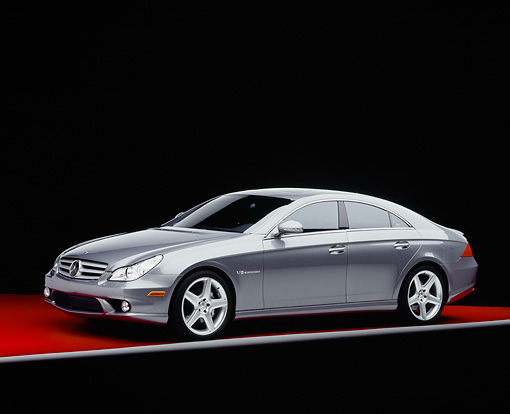 AUT 05 RK0470 01 © Kimball Stock 2006 Mercedes-Benz CLS55 AMG Gray 3/4 Side View On Red Floor Studio