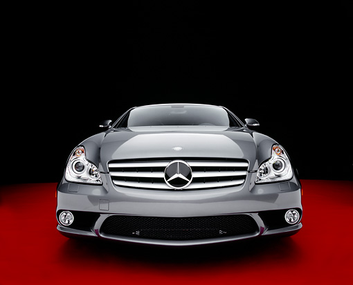 AUT 05 RK0472 07 © Kimball Stock 2006 Mercedes-Benz CLS55 AMG Gray Head On View On Red Floor Studio
