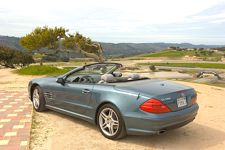 AUT 05 RK0485 01 © Kimball Stock 2006 Mercedes-Benz SL500 Convertible Blue 3/4 Rear View Mountains Background
