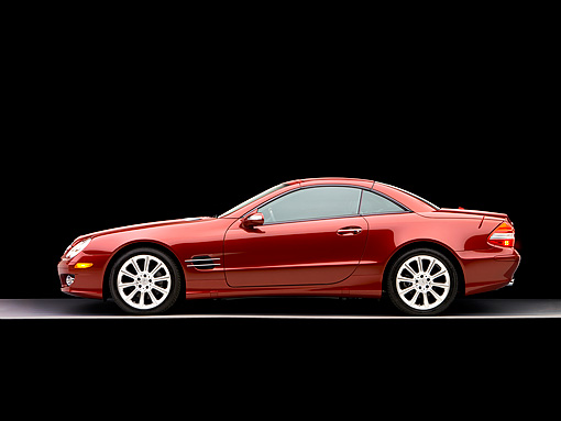 AUT 05 RK0492 01 © Kimball Stock 2007 Mercedes-Benz SL550 Roadster Storm Red Profile View Studio