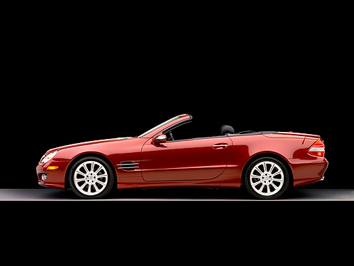 AUT 05 RK0493 01 © Kimball Stock 2007 Mercedes-Benz SL550 Roadster Storm Red Profile View Studio