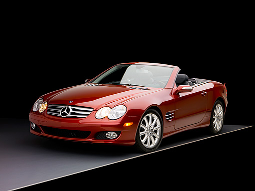 AUT 05 RK0495 01 © Kimball Stock 2007 Mercedes-Benz SL550 Roadster Storm Red 3/4 Front View Studio