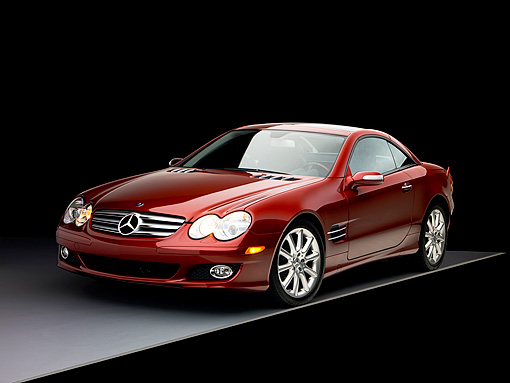 AUT 05 RK0496 01 © Kimball Stock 2007 Mercedes-Benz SL550 Roadster Storm Red 3/4 Front View Studio