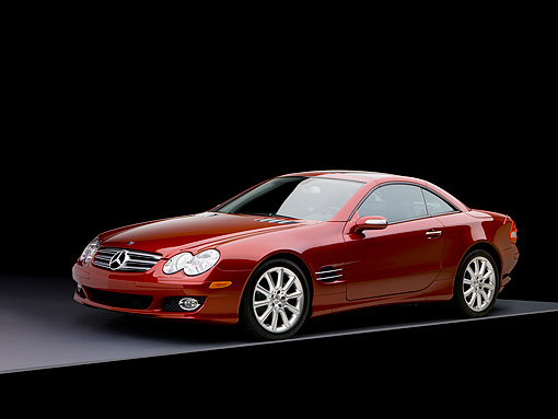 AUT 05 RK0497 01 © Kimball Stock 2007 Mercedes-Benz SL550 Roadster Storm Red 3/4 Side View Studio