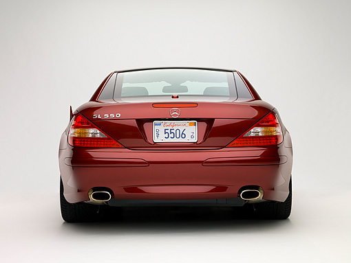 AUT 05 RK0502 01 © Kimball Stock 2007 Mercedes-Benz SL550 Roadster Storm Red Low Rear View Studio