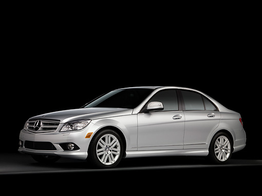 AUT 05 RK0560 01 © Kimball Stock 2008 Mercedes-Benz C300 Silver Sedan 3/4 Side View Studio