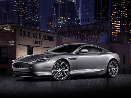 AUT 06 BK0004 01 © Kimball Stock 2012 Aston Martin DB9 Gray 3/4 Front View In City At Night