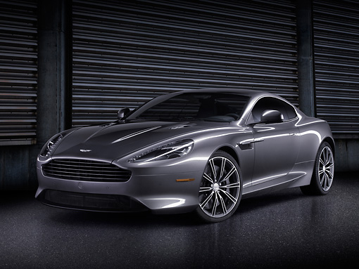 AUT 06 BK0005 01 © Kimball Stock 2012 Aston Martin DB9 Gray 3/4 Front View In Studio By Steel Door