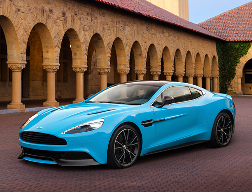 AUT 06 BK0009 01 © Kimball Stock 2013 Aston Martin Vanquish Blue 3/4 Front View On Brick By Building With Columns