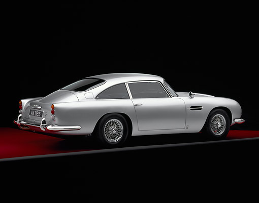 AUT 06 RK0010 04 © Kimball Stock 1964 Aston Martin DB5 Silver Rear 3/4 View On Red Floor Gray Line Studio
