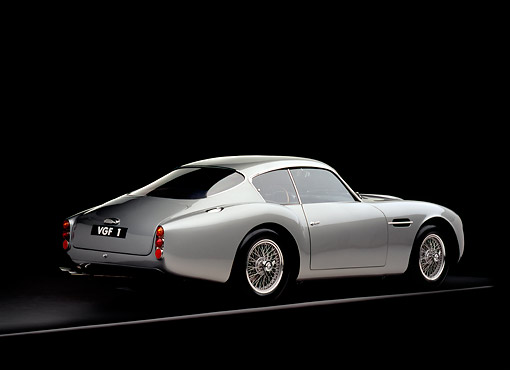 AUT 06 RK0027 02 © Kimball Stock 1962 Aston Martin DB4 GT Zagato Silver 3/4 Rear View On Gray Line Studio
