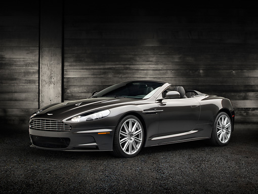 AUT 06 RK0146 01 © Kimball Stock 2012 Aston Martin DBS Gray 3/4 Front View On Pavement By Dark Wooden Wall